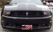 In God We Trust - American Flag - Arcylic License Plate on a Mustang
